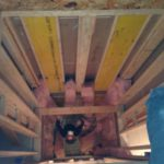 Insulating the elevator shaft.