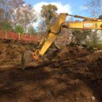 excavator digs basement