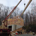 crane places main beam