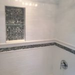 shower with subway tile & mosaic tile