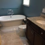 A beautiful soaking tub adds elegance to this bathroom.