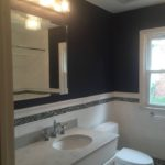 Subway tile and glass mosaic tile give this family bath a traditional look with a modern edge.